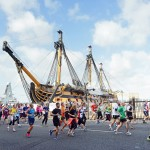 BUPA Great South Run in Portsmouth. Runners in the historic dockyard.